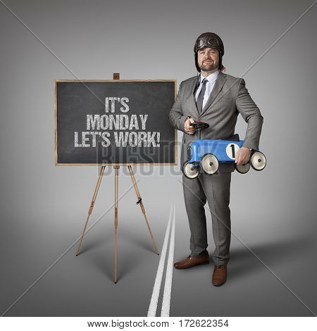 Its monday lets work text on blackboard with businessman and toy car