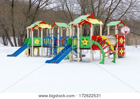 Colorful Playground On Yard In The Winter Park.
