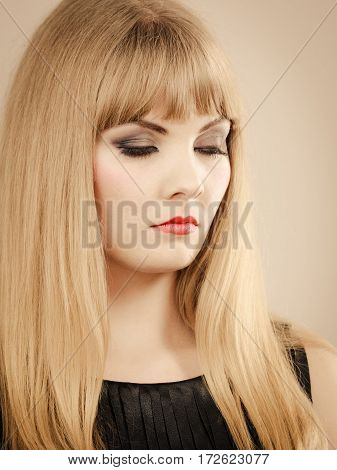 Dissatisfaction and unhappiness. Gorgeous beuty elegant young lady portrait. Angry dissatisfied attractive blonde stylish woman with strong make up.