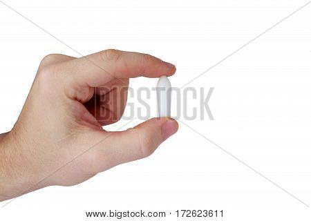 Rectal candle in hand on white background