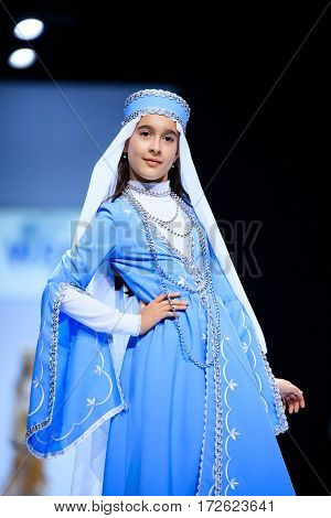 MOSCOW RUSSIA - OCTOBER 19 2016: Model walk runway for WORLD RUSSIAN BEAUTY catwalk at Spring-summer 2017 Moscow Fashion Week. Clothes in national ethnic style.