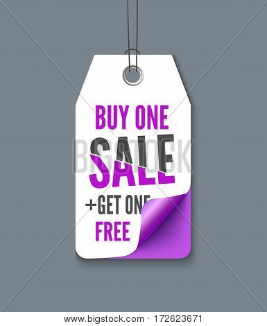 Violet tag with inscription Buy one - Get one free. Vector paper