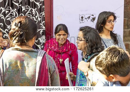 Women In India Listening To A Street Teacher In The Poor Area Of New Delhi, India
