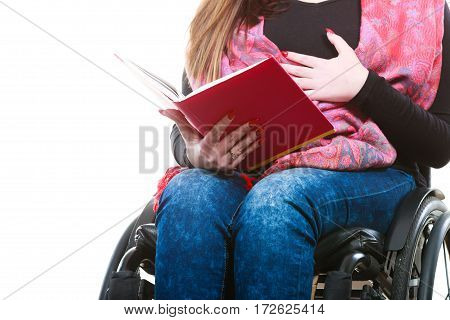 Young Disabled Woman In Wheelchair With Book.