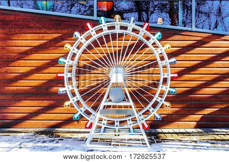 Layout part ferris wheel on a wooden background with free space