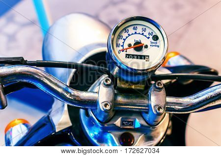 old scooter speedometer chrome high mileage travel concept