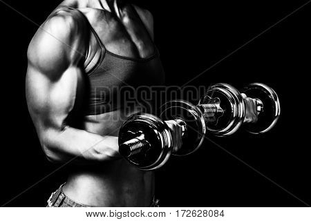 Fit woman with barbells, isolated on black