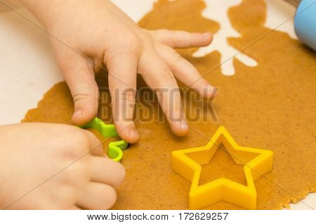 Making Homemade Christmas Cookies In Various Shapes