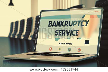 Bankruptcy Service on Landing Page of Laptop Screen in Modern Meeting Room Closeup View. Toned Image. Selective Focus. 3D Illustration.