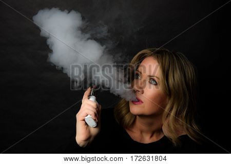 Low Key Image of A Blonde Woman Vaping