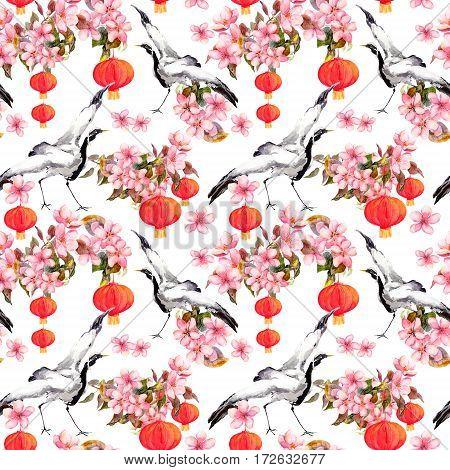 Red chinese lantern in spring pink flowers apple, plum, cherry, sakura and dancing crane birds. Seamless pattern. Watercolor