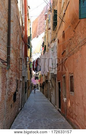 Venice Italy so many clothes hanging in the narrow street called Calle in italian
