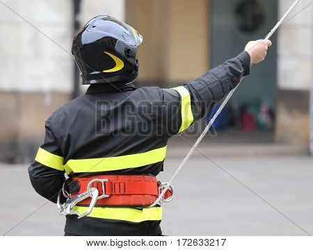 Firefighter With Hardhat During Rescue Operations With A Rope