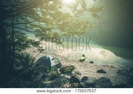 Scenic Lake Camping with Kayaking. Summer Lake Scenery.