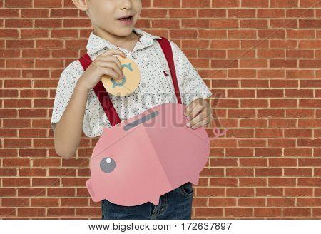 A Boy Saving Money Background Studio Portrait