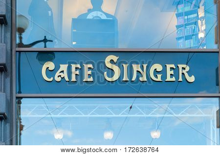 ST PETERSBURG RUSSIA-OCTOBER 3 2016. Singer cafe - inscription on the glass showcase of old Singer house building at Nevsky Prospect in St Petersburg Russia. St Petersburg Russia landmark