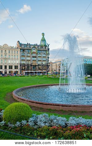 ST PETERSBURG RUSSIA - OCTOBER 3 2016. Zinger House on Nevsky Prospect in the historic center of the city and fountain on the foreground. St Petersburg Russia city landscape