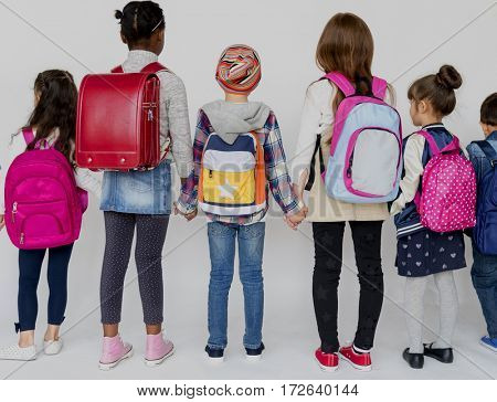 Group of Schoolers Kids with Backpack Behind Rear View on White Blackground