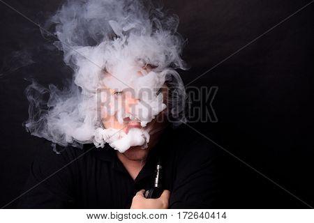 A Young Man Peering Through Vapor Smoke