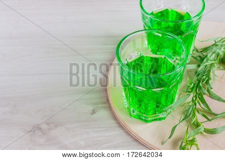 Water With Tarragon On A Wooden Surface