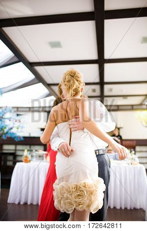 The groom unbuttoned my dress on the bride during a wedding dance. The groom is a big prankster.