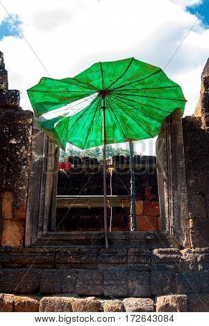 Wat Phu in Southern Laos - Parasol in window