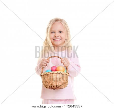 Cute funny girl holding wicker basket with Easter eggs on white background