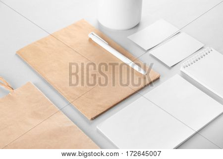 Flat lay of blank beige and white goods on table