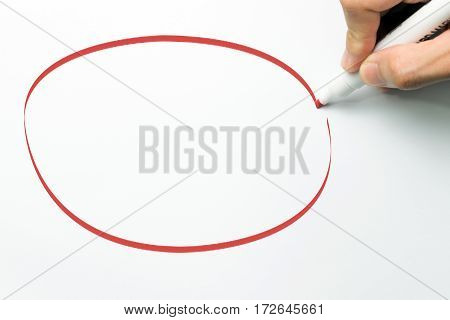 Hand draw big empty circle with red maker pen on white background