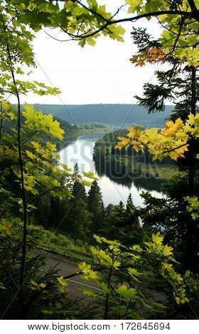 Bend In The River, Framed By Maple Leaves