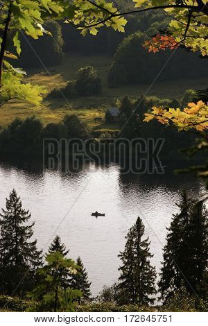 Lonely Boat In The Middle Of The River At Summer