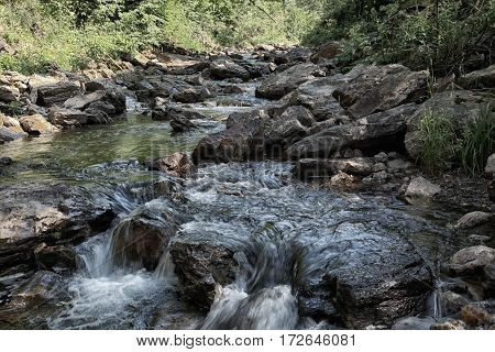 Small Waterfall Of Mountain River In Summer