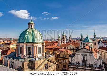 Aerial view of old town of Prague and the cupola of the Knights of the Cross church