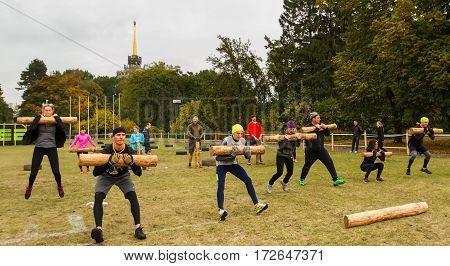 Kiev Ukraine - October 08. 2016. Street workout CrossFit training. Participants training perform long jump with a log on his hands.