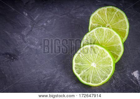Slices Of Lime On A Gray Marble Background