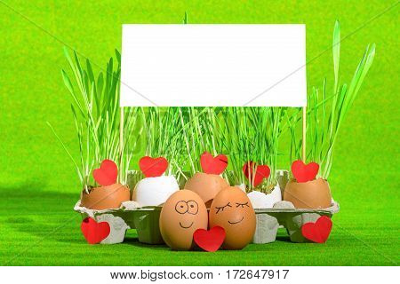 two funny eggs celebrating easter with blank an red hearts of love