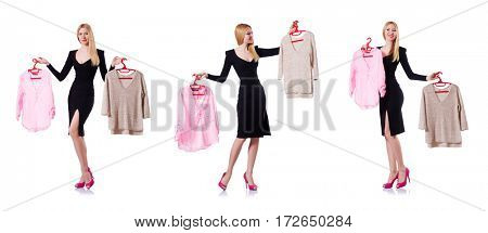 Woman trying to choose dress on white