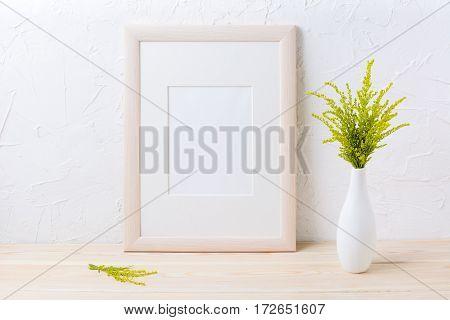 Wooden frame mockup with ornamental grass in exquisite vase. Empty frame mock up for presentation design.
