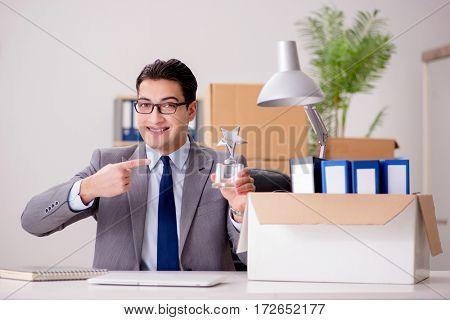 Businessman receiving star award in office