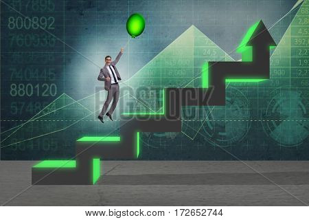 Businessman flying on hot balloon over graph