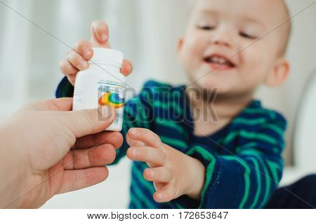 A child catches a lot of vitamin that pours from banks