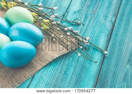 Colored Easter Eggs On A Wooden Background