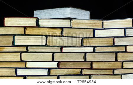Big Pile Of Books On Dark Background Close Up