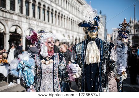 People with traditional mask at the Venice carnival 2017