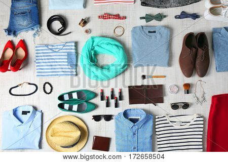 Stylish clothing set on wooden background
