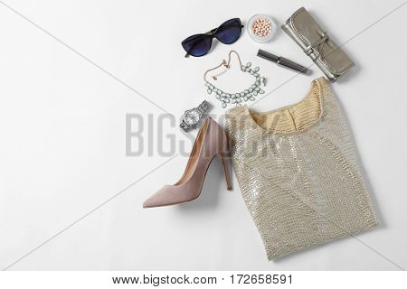 Flat lay set of female clothes and accessories on white background