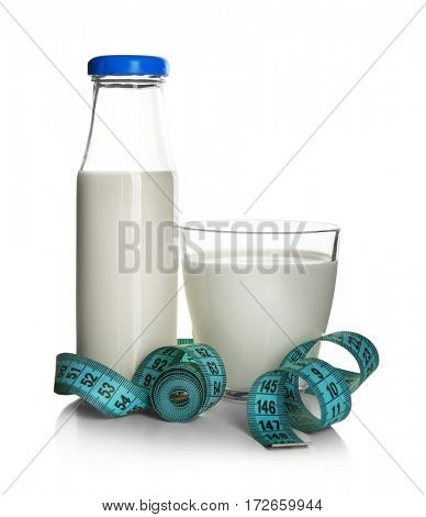 Diet concept. Milk and measuring tape isolated on white