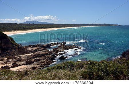 Beach at Cuttagee Point in summertime NSW Australia.