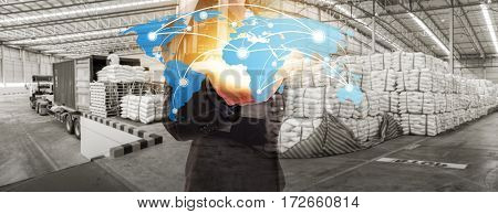Global network coverage world map on hand of businessman Distribution of goods in warehouse process for Logistic Import Export background (Elements of this image furnished by NASA)