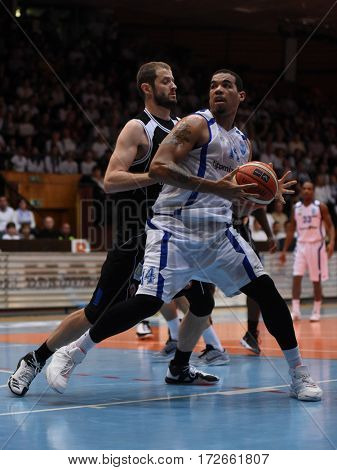 KAPOSVAR, HUNGARY - FEBRUARY 4: Kenneth Simms (white 14) in action at Hungarian Championship basketball game with Kaposvar (white) vs. Pecsi VSK (black) on February 4, 2017 in Kaposvar, Hungary.